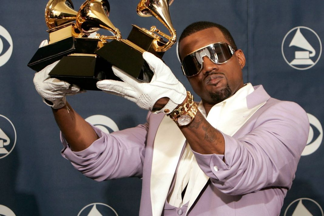 Kanye West with a bunch of Grammys. (Kevin Winter/Getty)